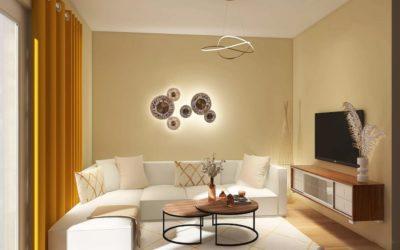 Stilvolles Wohnzimmer in Naturtönen und Gold-Elementen